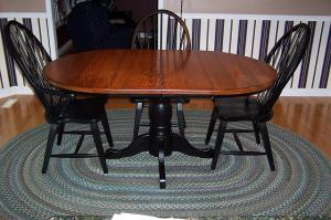 round oak table 4 black chairs